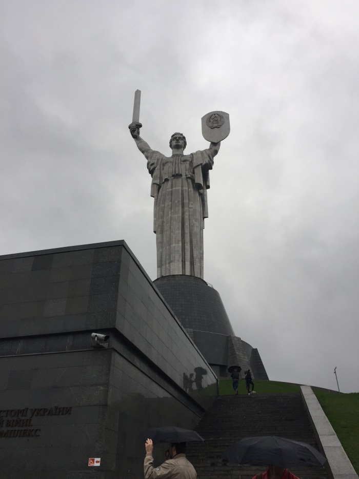 Rodina Mat, statue of the motherland with giant hammer and sickle on the shield